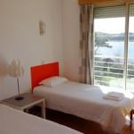 Stage natation à Porto, auberge de jeunesse chambre twin avec salle de bain